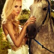 Portrait of gorgeous blonde girl with horse. — Stok fotoğraf