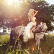 Beautiful photo of blonde sensual bride riding a horse. — Stock Photo