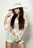 Beautiful summer girl posing in white hat — Stock Photo