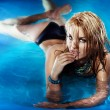 Portrait of sexy young female enjoying in swimming pool. — Stock Photo