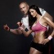 Very attractive fit couple at the gym . — Stock Photo #25949621