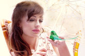 Calm conceptual portrait of attractive young lady with bird. — Stock Photo