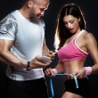 Picture of sporty wommeasuring her body at gym. — Stock Photo #25950303