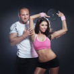 Beautiful athletic couple posing and training. — Stock Photo #27870433
