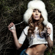 Portrait of attractive girl in fur hat. — Foto de Stock