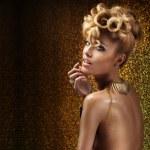 Gold beautiful woman posing. — Stock Photo