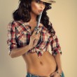 Beautiful brunette cowgirl. — Stok fotoğraf #41522751