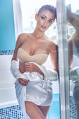 Sexy blonde woman in bathroom — Stock Photo
