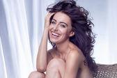 Portrait of brunette woman smiling — Stock Photo