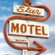 Small town neon motel sign - Stock Photo