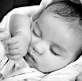 Black and White image of resting baby boy — Stock Photo