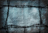 Red grunge frame with barbed wire — Stock Photo