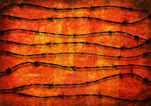 Barbed Wire background over red — Stock Photo