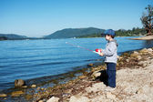 Small boy fishing — Stock Photo