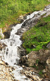 Very steep waterfall located in the north of Norway — Stock Photo