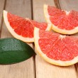 Stock Photo: Sliced red grapefruit on wooden background