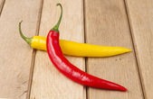 Red chili peppers on wooden background — ストック写真