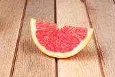 Grapefruit on a wooden board — Stock Photo