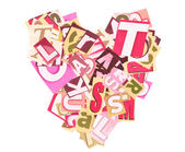 Heart made of newspaper clippings — Stock Photo