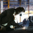 Worker using a welding torch — Stock Photo #24841411