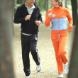 Couple jogging through the park — Stock Photo