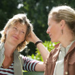 Two woman chatting in the park — Stock Photo