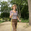 Active woman out cross country walking — Stock Photo