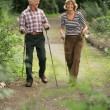 Active senior couple out walking — Stock Photo