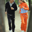Active mature couple jogging in the park — Stock Photo