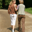 Two women enjoying a leisurely stroll — Stock Photo