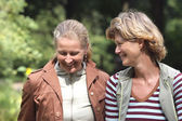 Female friends chatting in the park — Stock Photo