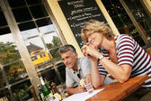 Mature couple dining at a restaurant — Stock Photo