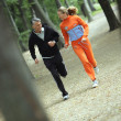 Energetic older couple out jogging — Stock Photo