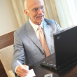 Stock Photo: Senior man working on a laptop