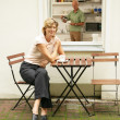 Stock Photo: Woman enjoying a cup of tea outdoors