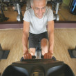 Mature man working out in a gym — Stock Photo