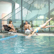 Woman diving into a swimming pool — 图库照片
