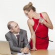 Seductive womholding chained businessman — Stock Photo #26609261