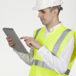 Stock Photo: Engineer using tablet