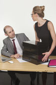 Male boss giving looks to the female assistant — ストック写真