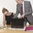 Dominant boss giving lots of work to his assistant — Stock Photo #26820767