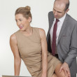 Stock Photo: Distasteful harassment by male boss