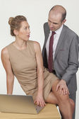 Boss harassing a female colleague — Stock Photo