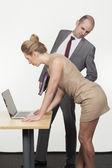 Boss ogling his secretary — Stock Photo