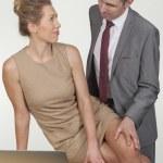 Businessman groping his secretary — Stock Photo #27635883