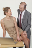 Businessman groping his secretary — Stock Photo