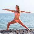 Stockfoto: Beautiful tanned womworking out at beach