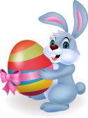 復活祭の卵を保持しているかわいいウサギの漫画 — ストックベクタ
