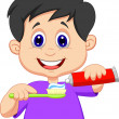 Kid squeezing tooth paste on a toothbrush — Stock Vector