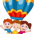 Happy kids riding a hot air balloon — Stockvectorbeeld